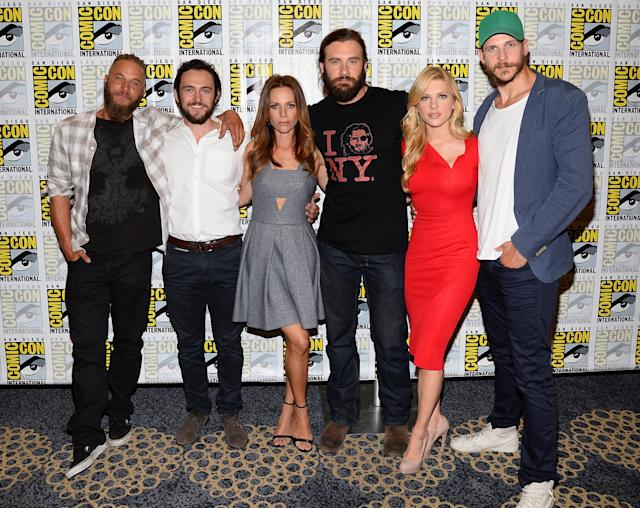 "Travis Fimmel, George Blagden, Jessalyn Gilsig, Clive Standen, Katheryn Winnick and Gustaf Skarsgard attend the ""Vikings"" Media Room during San Diego Comic Con 2013 at Hilton Bayfront on July 19, 2013 in San Diego, California."