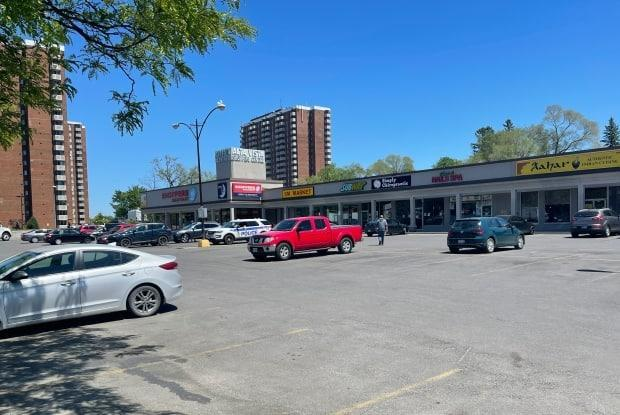 The parking lot of the Alta Vista Drive strip mall where 34-year-old Abdulaziz Abdullah and 27-year-old Mohamad Abdullah were shot to death on May 28, 2021, is seen here the following morning.