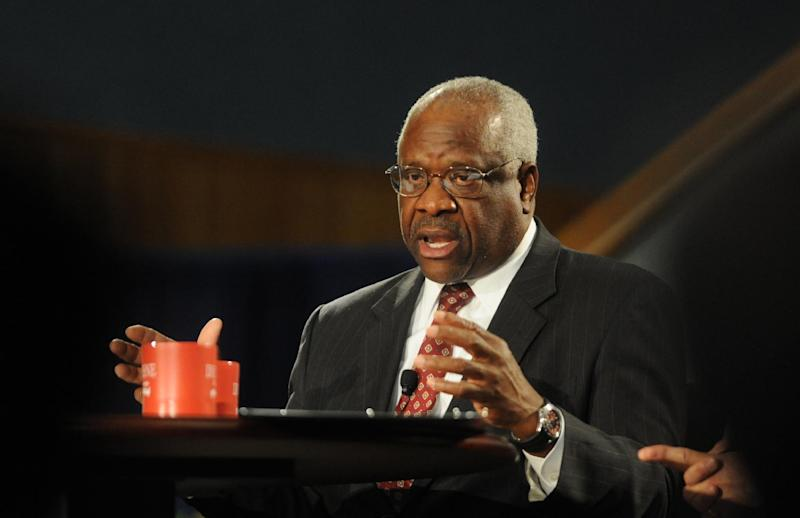Supreme Court Justice Clarence Thomas addresses the audience during a program at the Duquesne University School of Law on Tuesday April 9, 2013, in Pittsburgh. (AP Photo/Tribune Review, Sidney Davis) PITTSBURGH OUT, MANDATORY CREDIT