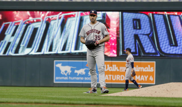 Houston Astros pitcher Justin Verlander (35) reacts after giving up a solo home run to Minnesota Twins' Ehire Adrianza in the third inning of a baseball game Monday, April 29, 2019, in Minneapolis. (AP Photo/Jim Mone)