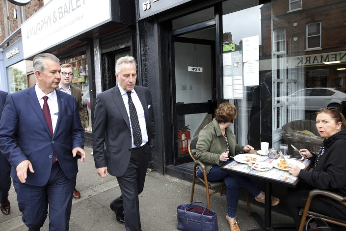Democratic Unionist Party members Edwin Poot, left, and Ian Paisley jnr leave the party headquarters in east Belfast after voting took place to elect a new leader on Friday May 14, 2021. Edwin Poots and Jeffrey Donaldson are running to replace Arlene Foster. (AP Photo/Peter Morrison)