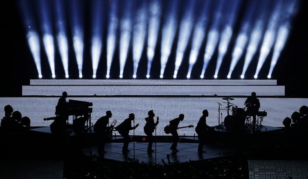 Bruno Mars performs during the halftime show of the NFL Super Bowl XLVIII football game Sunday, Feb. 2, 2014, in East Rutherford, N.J. (AP Photo/Charlie Riedel)