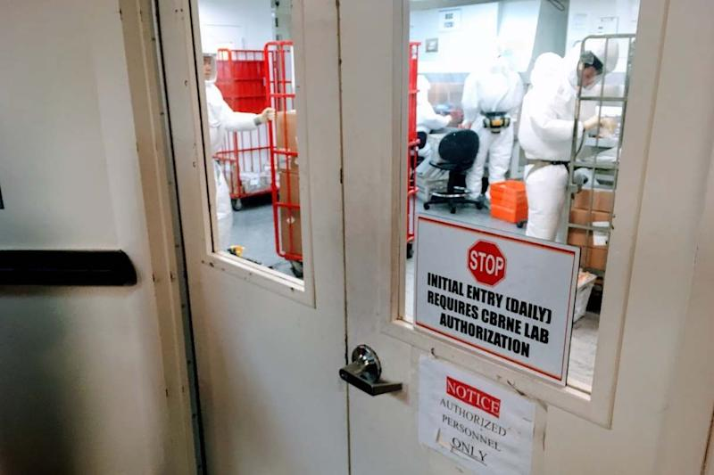 Staff screen mail as it arrives at a government facility in Washington DC (AFP via Getty Images)