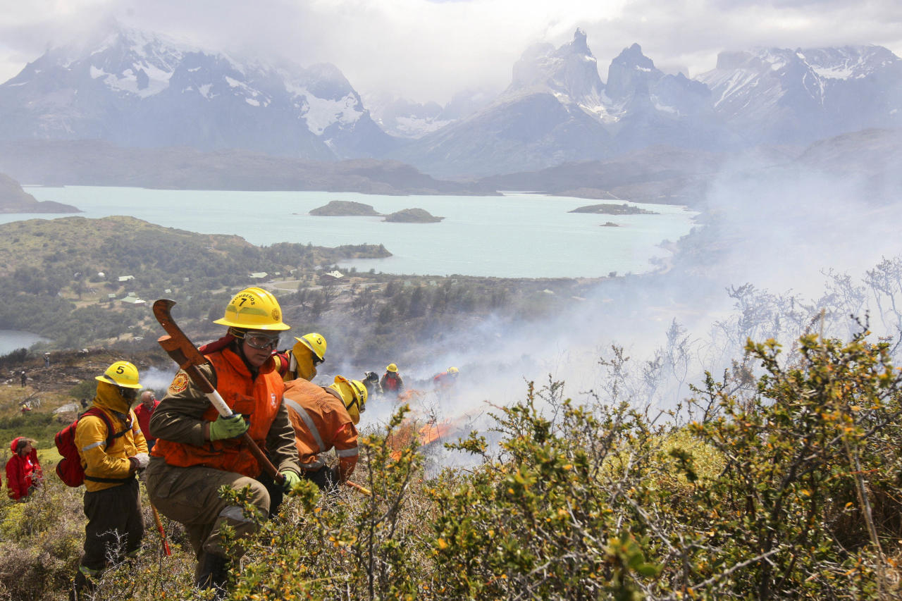 FILE - In this Jan. 1, 2012 file photo, firefighters work in Torres del Paine National Park in Torres del Paine, Chile. From Chile to Colombia to Mexico, Latin America has been battered recently by wildfires, floods and droughts. While leading climate scientists are unable to pin any single flood or heat wave solely on climate change, experts say the number of extreme weather events is increasing worldwide and the evidence suggests global warming is having an impact. (AP Photo, File)