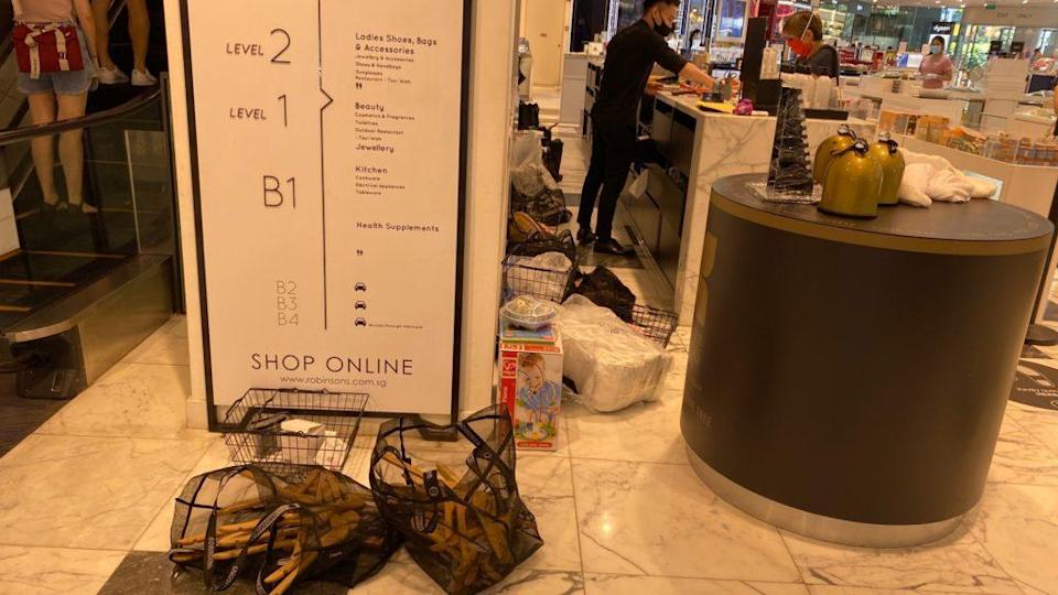 The clutter behind the cashier counter at The Heeren outlet. Photo: Coconuts