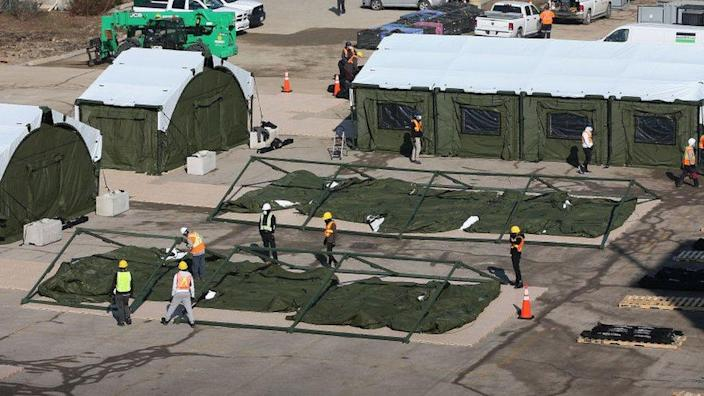 The Sunnybrook Hospital campus in Toronto will add 100 beds to the field hospital in the parking lot for fear of a third wave. Ontario relaxed restrictions to delay the spread of the COVID-19 pandemic.
