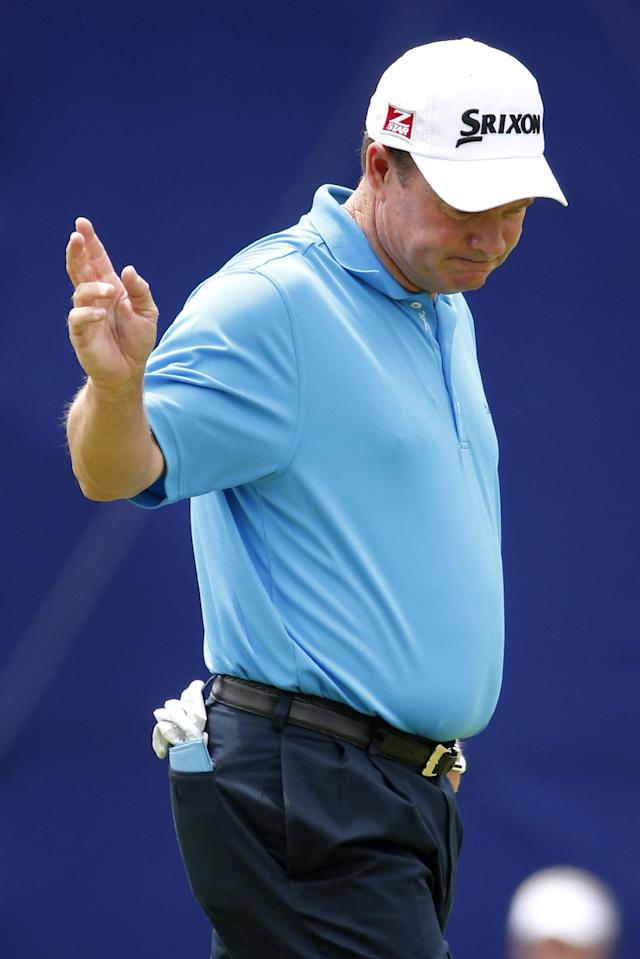 Joe Durant celebrates sinking a birdie putt on the 18th green during the first round of the Senior Players Championship golf tournament at Fox Chapel Golf Club in Pittsburgh, Thursday, June 26, 2014. Durant shot a 6-under-par round of 64, tied for the early lead. (AP Photo/Gene J. Puskar)