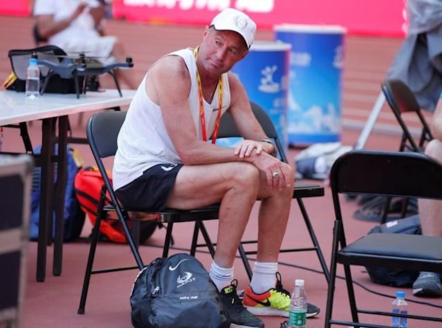 FILE PHOTO: Alberto Salazar, coach to Mo Farah of Britain and Galen Rupp of the U.S.A. sits inside the Bird's Nest Stadium at the Wold Athletics Championships in Beijing