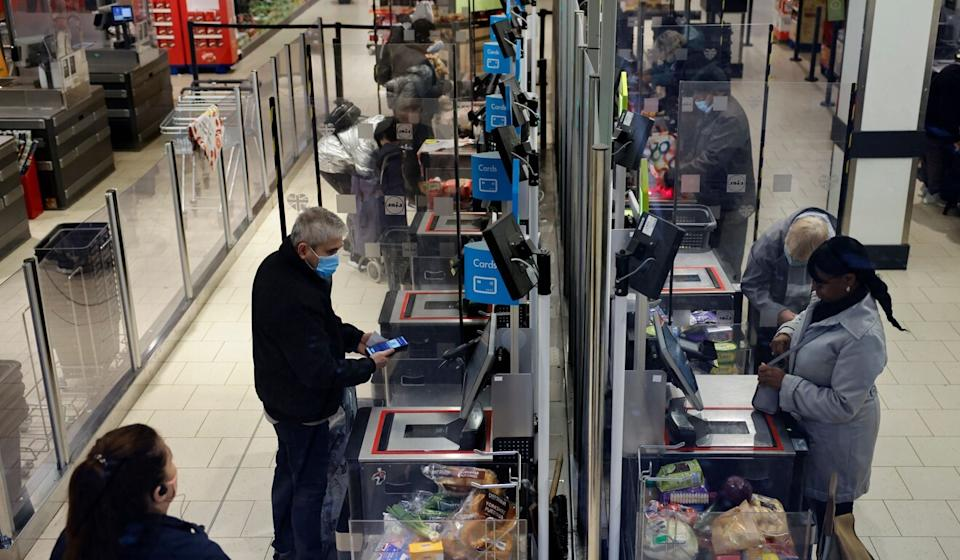 Grocery stores and supermarkets are adopting contactless payment technology to help maintain social distancing. Photo: AFP