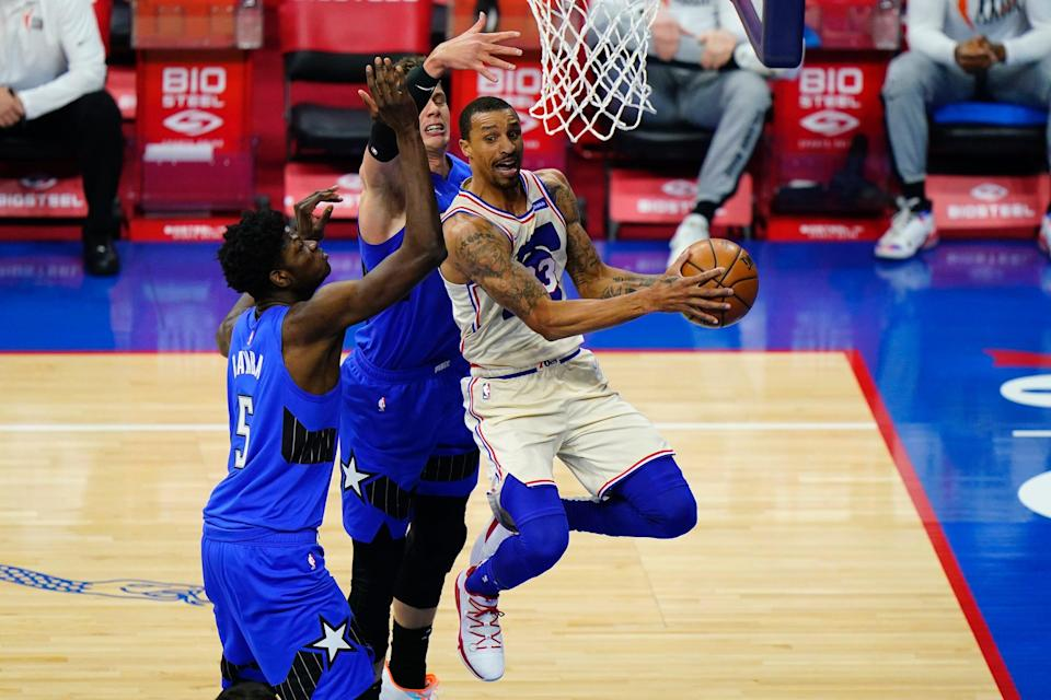 Philadelphia 76ers' George Hill, right, tries to get past Orlando Magic's Moritz Wagner, center, and Mo Bamba during a May 16 game.