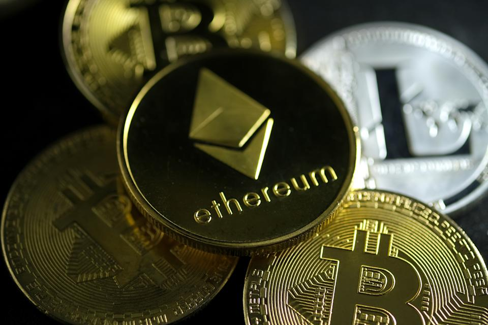 KATWIJK, NETHERLANDS - DECEMBER 17: In this photo illustration, visual representations of digital cryptocurrencies, Ethereum, Bitcoin and Litecoin, are arranged on December 17, 2020 in Katwijk, Netherlands.  (Photo by Yuriko Nakao/Getty Images)