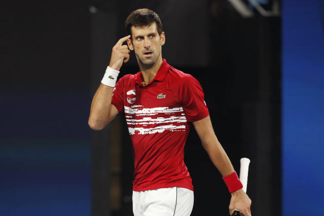 CAPTION CORRECTS SPELLING TO SURNAME Novak Djokovic of Serbia reacts as he plays Rafael Nadal of Spain during their ATP Cup tennis match in Sydney, Sunday, Jan. 12, 2020. (AP Photo/Steve Christo)