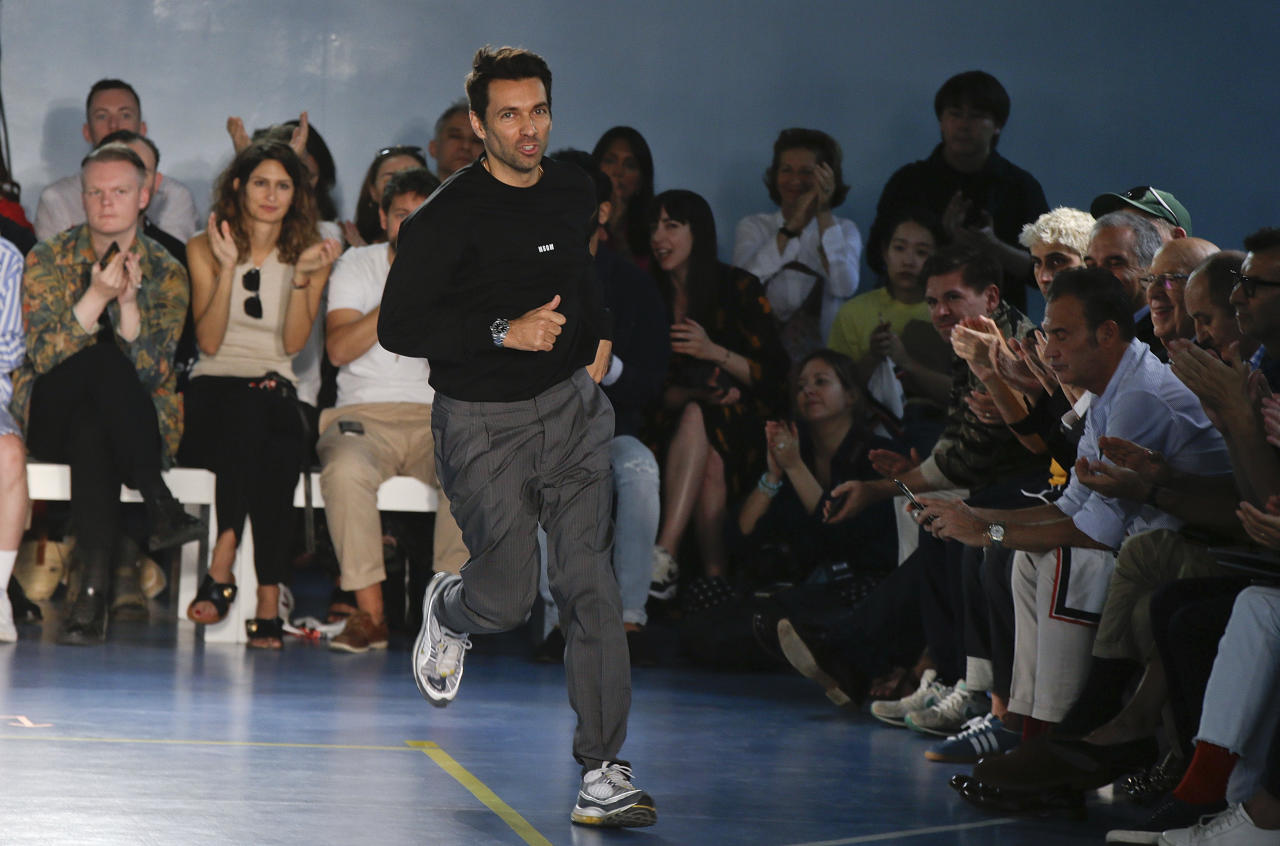 Fashion designer Massimo Georgette runs on the runway at the end of the MSGM, men's Spring-Summer 2019 collection, that was presented in Milan, Italy, Sunday, June 17, 2018. (AP Photo/Luca Bruno)
