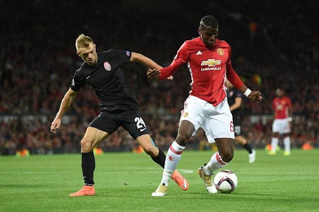 Zorya's Ukrainian midfielder Dmytro Grechyshkin (L) vies with Manchester United's French midfielder Paul Pogba during the UEFA Europa League group A football match between Manchester United and Zorya Luhansk (AFP Photo/Paul Ellis)