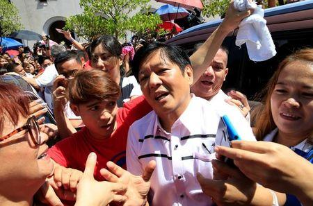 "Philippine vice-presidential candidate senator Ferdinand ""BongBong"" Marcos is greeted by supporters after attending a mass at a Catholic church in Paranaque city, metro Manila"