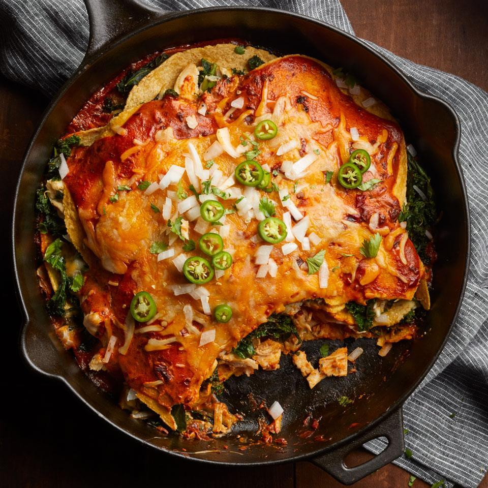 "<p>Put out your favorite toppings for these quick and healthy layered enchiladas. We like cilantro, sour cream, guacamole and jalapeños. <a href=""http://www.eatingwell.com/recipe/260921/adobo-chicken-kale-enchiladas/"" rel=""nofollow noopener"" target=""_blank"" data-ylk=""slk:View recipe"" class=""link rapid-noclick-resp""> View recipe </a></p>"