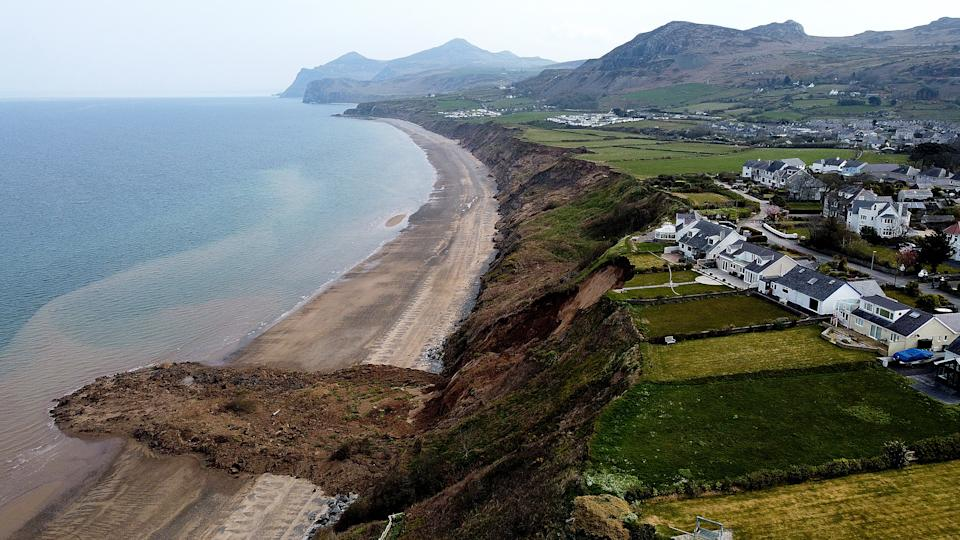 Houses are seen on the edge of a cliff after it collapsed in the village of Nefyn, Wales, Britain, April 20, 2021. Picture taken with a drone. REUTERS/Carl Recine