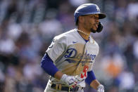 Los Angeles Dodgers' Mookie Betts runs up the first base line after popping out against Colorado Rockies relief pitcher Mychal Givens in the ninth inning of a baseball game Sunday, April 4, 2021, in Denver. The Dodgers won 4-2. (AP Photo/David Zalubowski)