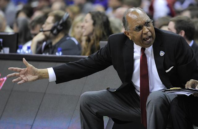 KANSAS CITY, MO - MARCH 9: Tubby Smith head coach of the Texas Tech Red Raiders talks to members of his team on the bench during a game TCU Horned Frogs in the second half of the first round of the Big 12 Basketball Tournament at Sprint Center on March 9, 2016 in Kansas City, Missouri. TCU won 67-62. (Photo by Ed Zurga/Getty Images)