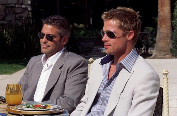 """(L-R) George Clooney and Brad Pitt in """"Ocean's Eleven."""""""