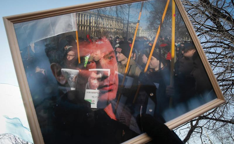 Protesters are reflected in the frame of a portrait during a rally in memory of opposition leader Boris Nemtsov in St. Petersburg, on February 29.