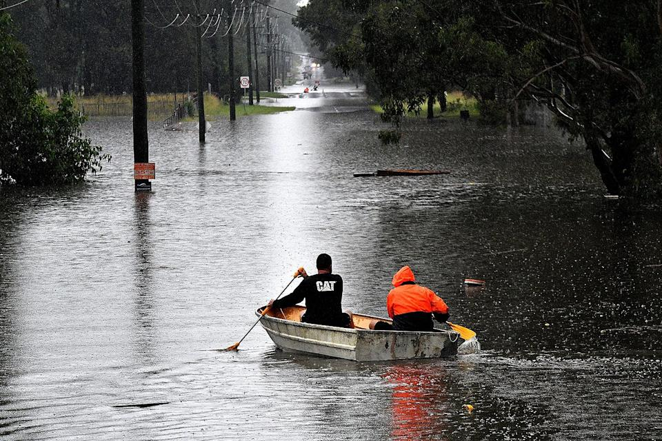 <p>People make their way through flooded streets by boat in Windsor on March 22. Torrential downpours are to blame for the treacherous conditions.</p>