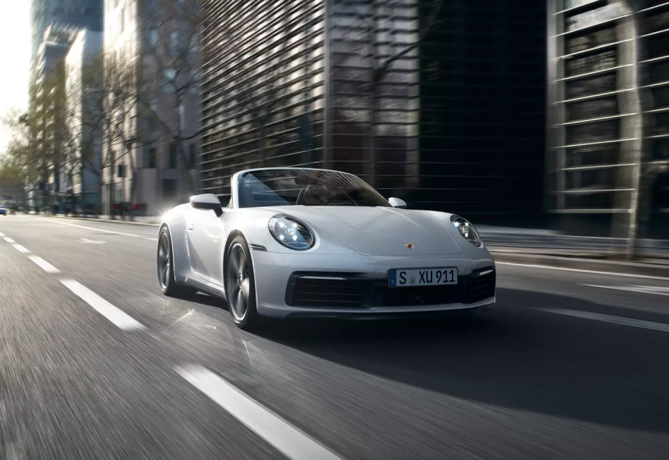 "<p>From its rear-mounted flat-six engine to its otherworldly handling, the <a href=""https://www.caranddriver.com/porsche/911"" rel=""nofollow noopener"" target=""_blank"" data-ylk=""slk:Porsche 911"" class=""link rapid-noclick-resp"">Porsche 911</a> has preserved the essential elements that made it an icon. Its familiar circular headlights, Coke bottle shape, and sloping rump make it virtually impossible to mistake a 911 for any other sports car. Climb into its perfectly positioned driver's seat, fire up its powerful and unique-sounding engine, and engage either of its terrific transmissions; <a href=""https://www.caranddriver.com/porsche"" rel=""nofollow noopener"" target=""_blank"" data-ylk=""slk:Porsche's"" class=""link rapid-noclick-resp"">Porsche's</a> legendary 2+2-seater will then proceed to overload you with feedback from its telepathic steering and its peerless performance attributes. It's offered as a coupe or convertible and with rear- or all-wheel drive. The company's extensive list of options allows it to be personalized for all tastes. The only knock against the 2021 911 is that it's too expensive for most enthusiasts to own.</p><p><a class=""link rapid-noclick-resp"" href=""https://www.caranddriver.com/porsche/911"" rel=""nofollow noopener"" target=""_blank"" data-ylk=""slk:Review, Pricing, and Specs"">Review, Pricing, and Specs</a></p>"