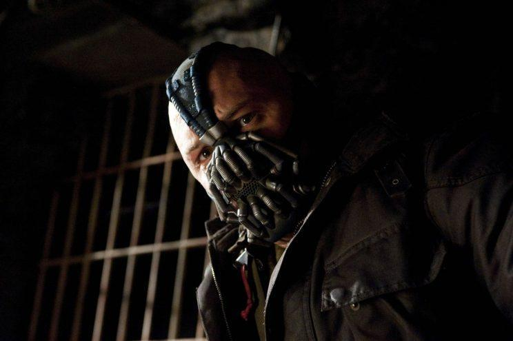 Cover up… Tom Hardy's face often obscured by stuff – Credit: Warner Bros