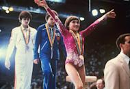<p>Gold medalist Yelena Davydova of Russia walks off stage after the women's gymnastics all- around Olympic competition at the 1980 Moscow Olympics. (AP Photo/Maze) </p>
