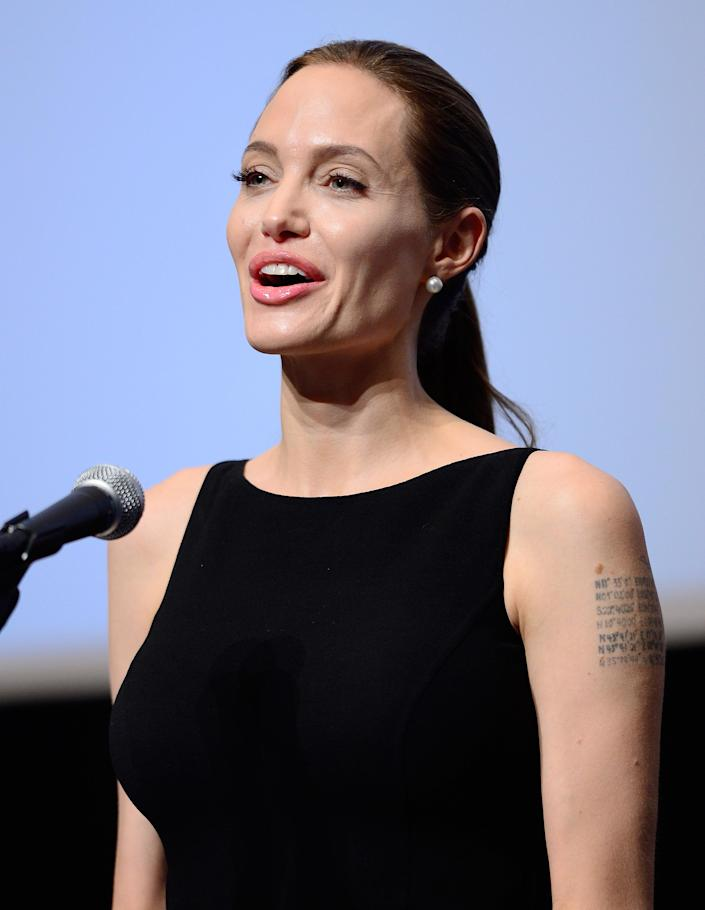These days, <b>Angelina Jolie</b> is one of the foremost Hollywood humanitarians, always devoting her life to a philanthropic cause. But Jolie wasn't always a good girl. Her edgy image in her earlier days resulted in at least a dozen tattoos, including the Buddhist scripture written on her left arm that's visible whenever she wears a sleeveless gown on the red carpet.
