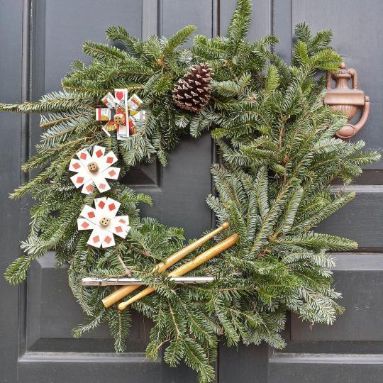<p>Some of the wreaths get creative with materials. This one incorporates playing cards and drumsticks. <i>(Photo: Christian Carollo/Say Hello to America)</i></p>