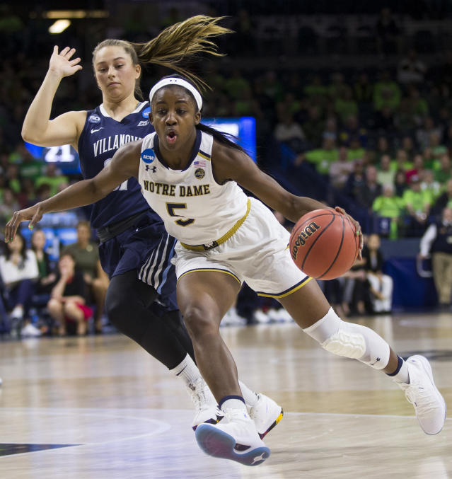 Notre Dame's Jackie Young, right, drives by Villanova's Adrianna Hahn, left, during a second-round game in the NCAA women's college basketball tournament Sunday, March 18, 2018, in South Bend, Ind. (AP Photo/Robert Franklin)