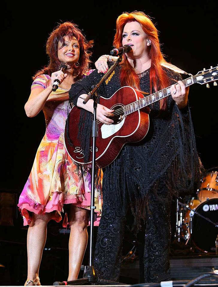 """The Judds, country music's favorite dysfunctional family, recently reunited for a """"special"""" concert in Palm Springs, CA. 62-year-old mom Naomi opted for Debbie Gibson's prom dress, while daughter Wynonna decided on a sparkling Stevie Nicks-inspired muumuu. John Shearer/<a href=""""http://www.wireimage.com"""" target=""""new"""">WireImage.com</a> - May 3, 2008"""