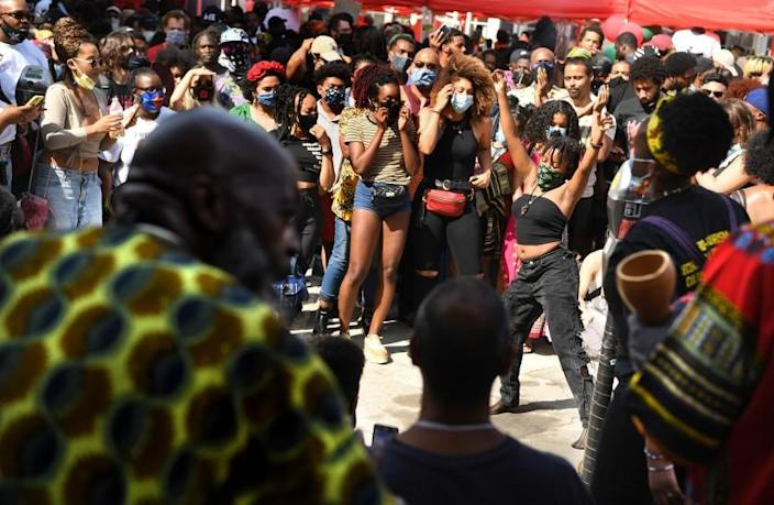 LOS ANGELES, CALIFORNIA JUNE 19, 2020-A woman dances to the music during a Juneteenth celebration at Leimert Park Friday. (Wally Skalij/Los Angeles Times)