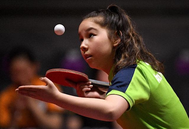 Eleven-year-old table tennis player Anna Hursey of Wales is thought to be the youngest ever athlete at the Commonwealth Games. (AFP Photo/WILLIAM WEST)