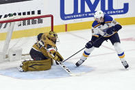 St. Louis Blues defenseman Colton Parayko (55) scores against Vegas Golden Knights goaltender Marc-Andre Fleury (29) during the second period of an NHL hockey game Saturday, May 8, 2021, in Las Vegas. (AP Photo/David Becker)