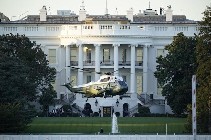 Marine One lifts off from the White House to carry President Donald Trump to Walter Reed National Military Medical Center in Bethesda, Md., Friday, Oct. 2, 2020 in Washington. (AP Photo/J. Scott Applewhite)