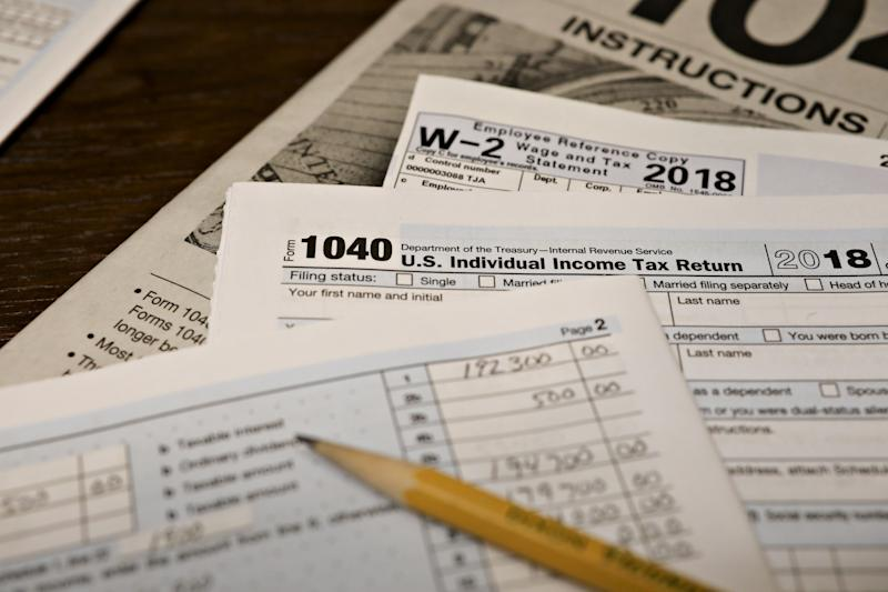 U.S. Department of the Treasury Internal Revenue Service (IRS) 1040 Individual Income Tax forms for the 2018 tax year are arranged for a photograph in Tiskilwa, Illinois, U.S., on Monday, March 11, 2019. Fewer people are getting refunds this year and that's causing angst for Republicans who want to convince voters that the 2017 tax overhaul really did give them a tax cut. Photographer: Daniel Acker/Bloomberg via Getty Images