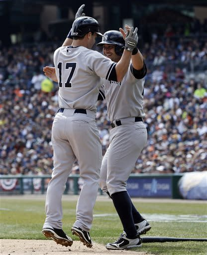 New York Yankees' Jayson Nix (17) is congratulated by teammate Francisco Cervelli after they both scored on Nix's two-run home run during the second inning of a baseball game against the Detroit Tigers in Detroit, Sunday, April 7, 2013. (AP Photo/Carlos Osorio)