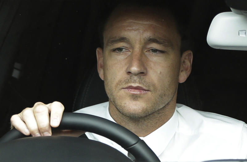 ALTERNATE CROP OF LLP101  Former England soccer captain John Terry drives out of Wembley Stadium in London, Tuesday, Sept. 25, 2012, where the Football Association hearing on a racism charge against him was held. Terry's racism hearing started Monday, a day after the 31-year-old Chelsea defender quit England duty in protest at the case being pursued by the Football Association. Terry was charged by the FA despite being cleared in court of racially abusing Queens Park Rangers defender Anton Ferdinand during a Premier League match in October. (AP Photo/Lefteris Pitarakis)