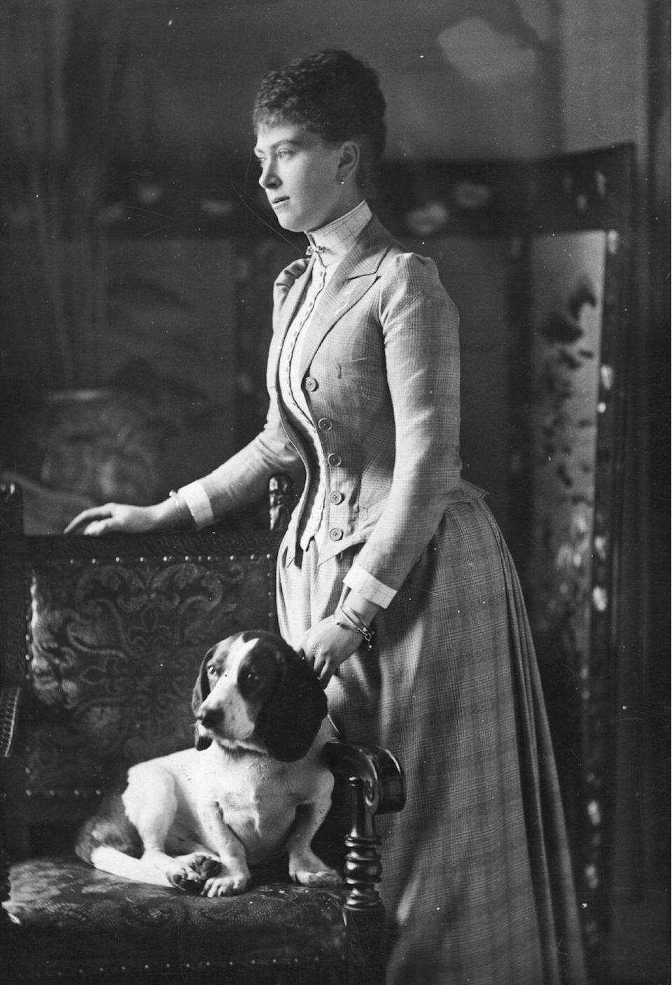<p>Mary of Teck—the future Queen Mary—was photographed with a dog in the late 19th century. </p>