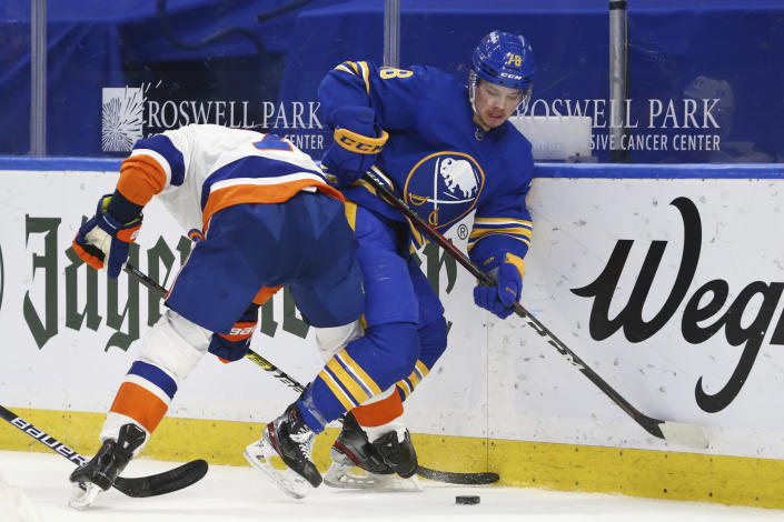 Buffalo Sabres defenseman Jacob Bryson (78) is checked by New York Islanders forward Jordan Eberle (7) during the second period of an NHL hockey game, Monday, May 3, 2021, in Buffalo, N.Y. (AP Photo/Jeffrey T. Barnes)