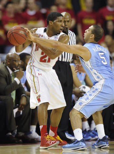 North Carolina guard Kendall Marshall (5) reaches for the ball against Maryland guard Pe'Shon Howard (21) during the first half of an NCAA college basketball game, Saturday, Feb. 4, 2012, in College Park, Md. (AP Photo/Nick Wass)