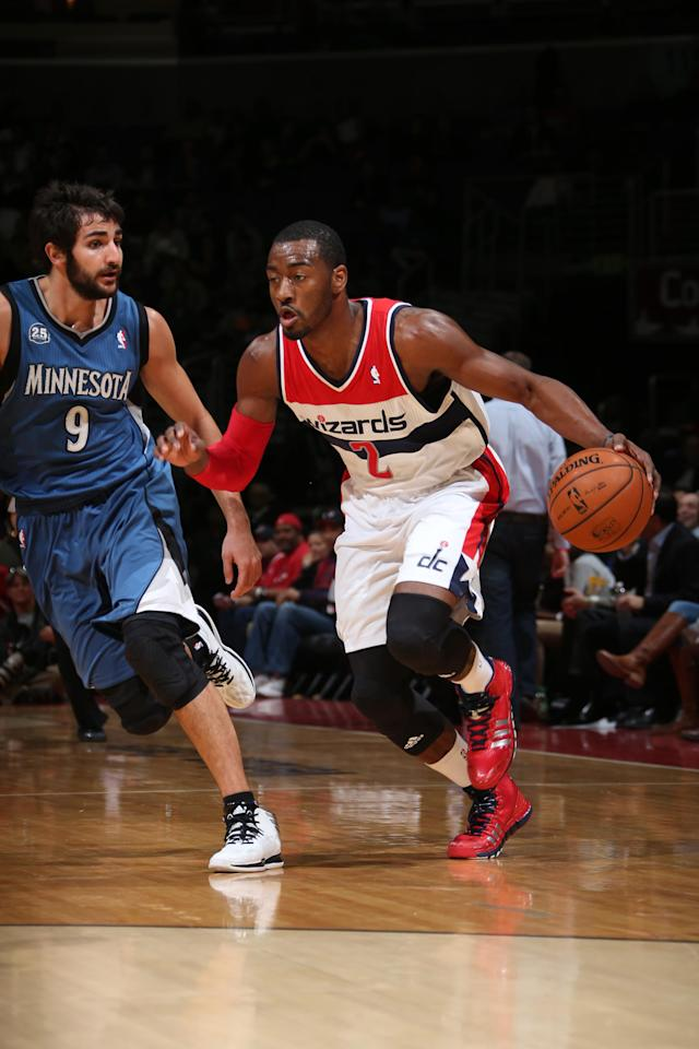 WASHINGTON, DC - NOVEMBER 19: John Wall #2 of the Washington Wizards drives against Ricky Rubio #9 of the Minnesota TImberwolves during the game at the Verizon Center on November 19, 2013 in Washington, DC. (Photo by Ned Dishman/NBAE via Getty Images)