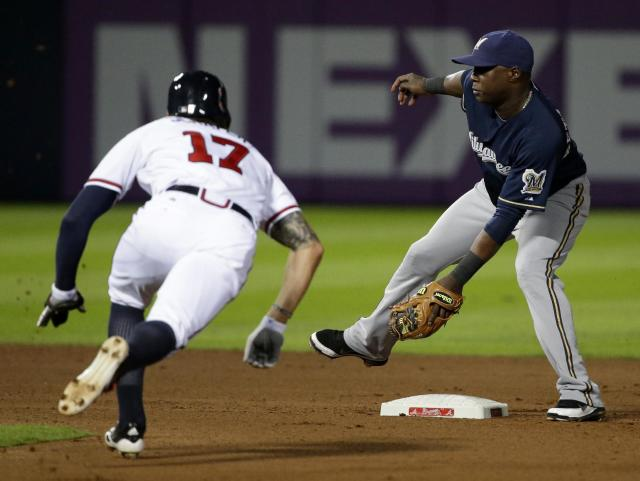 Milwaukee Brewers' Yuniesky Betancourt, right, waits for the throw as Atlanta Braves' Jordan Schafer steals second base in the fourth inning of a baseball game, Monday, Sept. 23, 2013, in Atlanta. (AP Photo/David Goldman)