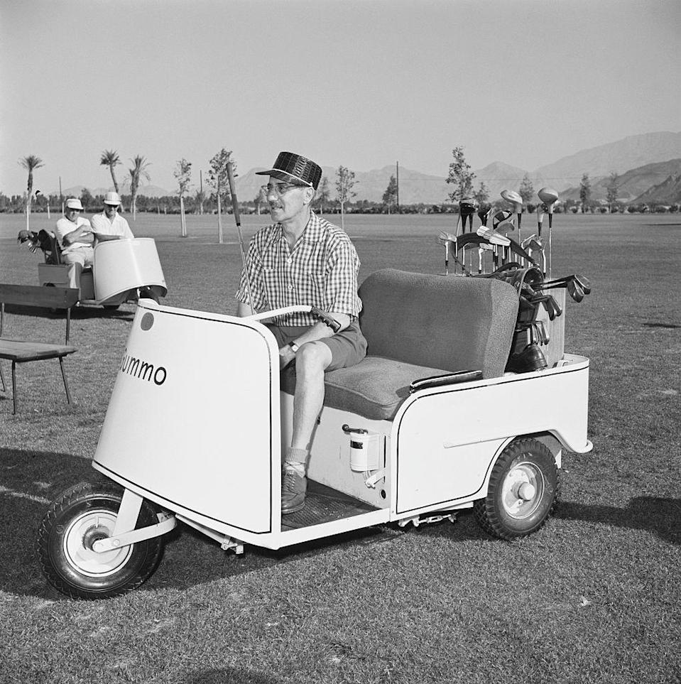<p>Comedian and actor Groucho Marx sits in a golf cart in between rounds. The funnyman, along with his three siblings, made up The Marx Brothers comedy group.</p>
