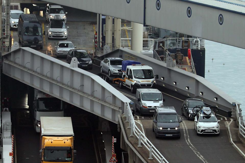 Vehicles are driven off a ferry at Dover after arriving from France (PA)