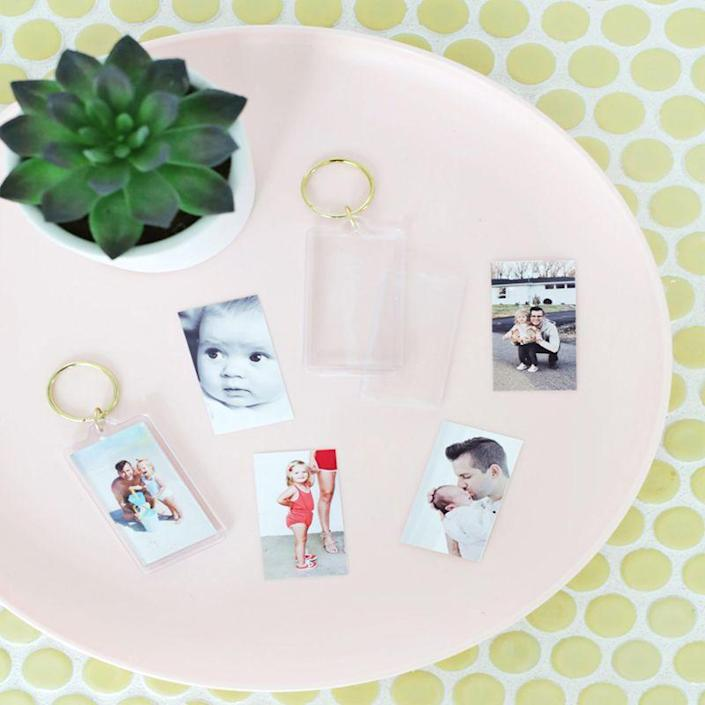 """<p>Dad will always have a piece of his family wherever he goes with these homemade photo keychains. </p><p><em>Get the tutorial at </em><em><a href=""""https://abeautifulmess.com/2019/06/easy-photo-keychain-diy.html"""" rel=""""nofollow noopener"""" target=""""_blank"""" data-ylk=""""slk:A Beautiful Mess"""" class=""""link rapid-noclick-resp"""">A Beautiful Mess</a></em><em>.</em><br><br><a class=""""link rapid-noclick-resp"""" href=""""https://www.amazon.com/Acrylic-Photo-Keychain-Blanks-Inches/dp/B08CZHFXJ5/ref=sr_1_7?tag=syn-yahoo-20&ascsubtag=%5Bartid%7C10070.g.32697573%5Bsrc%7Cyahoo-us"""" rel=""""nofollow noopener"""" target=""""_blank"""" data-ylk=""""slk:SHOP PHOTO KEYCHAINS"""">SHOP PHOTO KEYCHAINS</a></p>"""