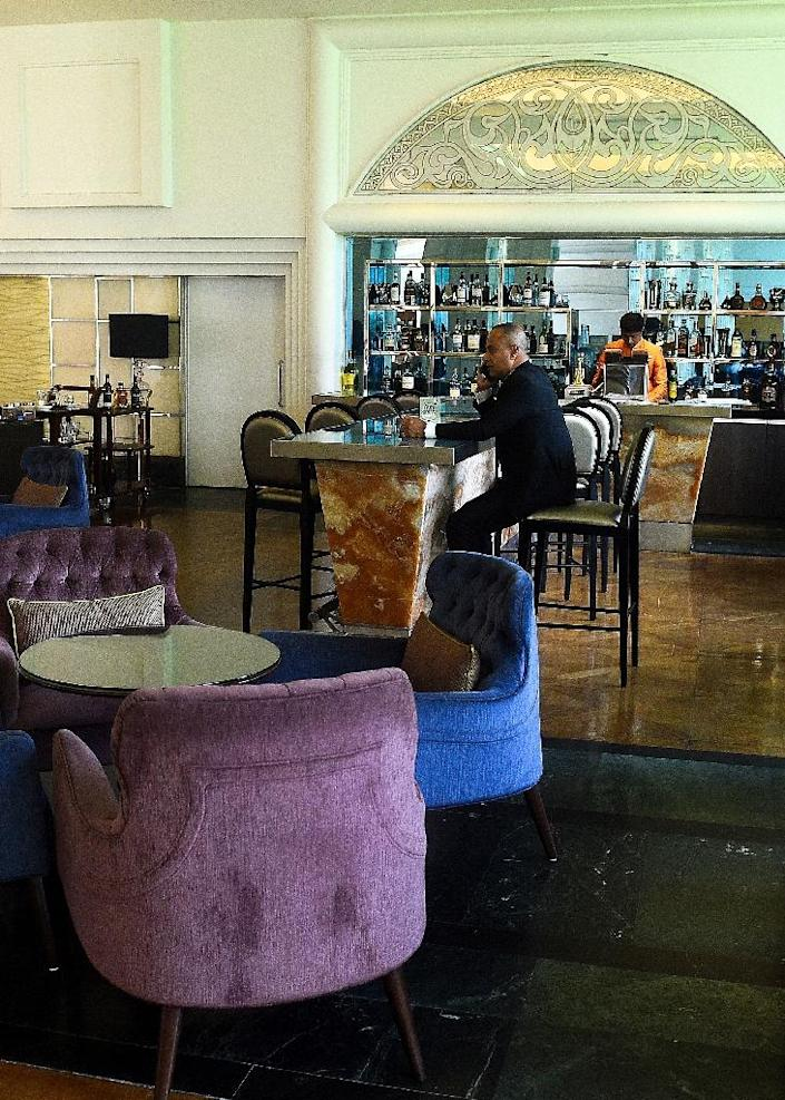 The bar inside the hotel was a popular drinking hole for Colombo's movers and shakers before the attacks (AFP Photo/ISHARA S. KODIKARA)