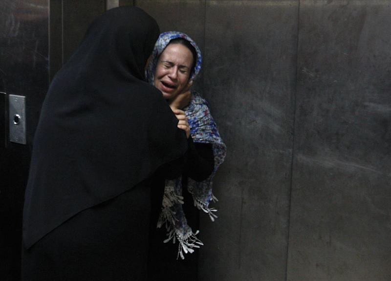 A Palestinian woman cries at a hospital in Gaza City, Saturday, Nov. 10,2012. An explosion targeted an Israeli military vehicle on Jewish state's border with Gaza on Saturday and Israeli troops fired into the Palestinian territory, killing several civilians and wounding at least 25, Gaza officials and witnesses said. (AP Photo/Hatem Moussa)